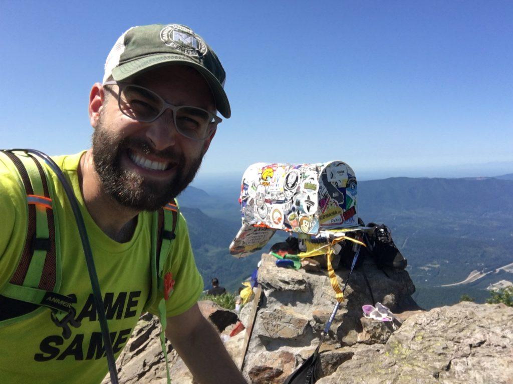 beau chevassus hiking on mailbox peak at summit top